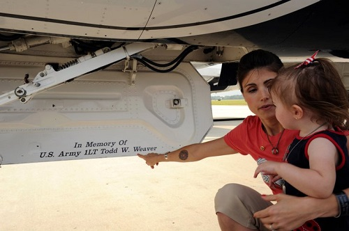 Emma Weaver,and her daughter, takes a moment to look at Lt. Weaver's name displayed on Thunderbird 1's jet during the Airpower Over Hampton Roads air show, Langley Air Force Base,